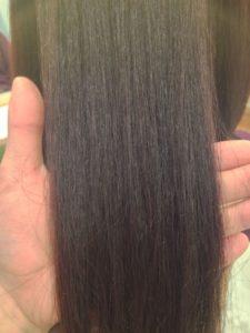 東京銀座、縮毛矯正でチリチリしたくせ毛が綺麗に伸びてる髪
